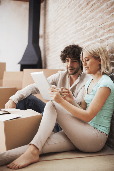 couple planning with moving boxes