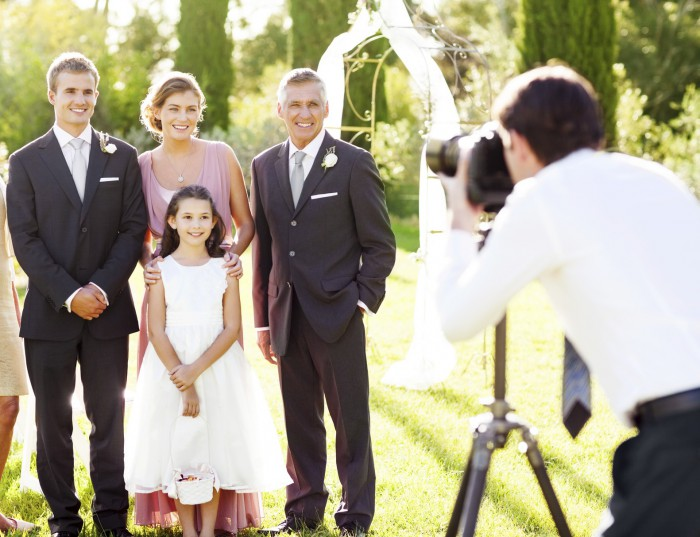 Happy family posing for wedding photography